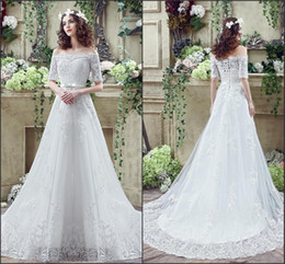 Wholesale cheap real designer - Real Photos Cheap Lace Wedding Dresses Pleats Off Shoulder 1 2 Sleeves Applique Tulle Lace Up Back Side Split Wedding Gowns With Sashes