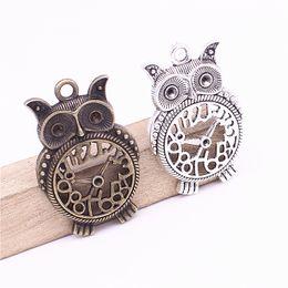 Wholesale Owl Pendant Silver Bronze - 31*50mm Antique Bronze Metal Zinc Alloy Hollow Animal Owl Charms Diy Clock Owl Pendant Charms Jewelry Making D1210