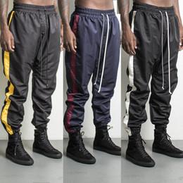 Wholesale Hip Hop Track Pants - 2017 NEW TOP kanye west jumpsuit men gym clothing pants hip hop patched track beam foot trousers Side zipper sports pants 30-36