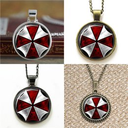 Paraguas malvado residente online-10pcs Resident Evil Umbrella Corporation Glass Photo Necklace keyring bookmark gemelos pulsera del pendiente