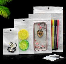 La mejor calidad Clear + white pearl Plastic Poly OPP embalaje cremallera Zip lock Paquetes al por menor Joyería comida PVC bolsa de plástico muchos tamaños disponibles desde fabricantes