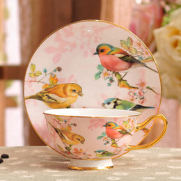 Wholesale Cup Coffee Saucer - Porcelain tea cup and saucer ultra-thin bone china flowers and birds pattern design outline in gold coffee cup and saucer set