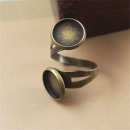 Wholesale Antique Ring Base - BoYuTe New Product 20Pcs Round 12mm Cabochon Base Ring Setting Antique Bronze Plated Adjustable Ring Blanks