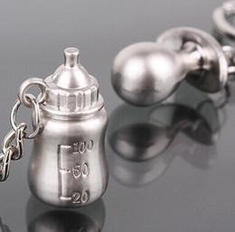 Wholesale- 1pairs Portachiavi placcato argento Bottiglia di latte Capezzolo Portachiavi baby shower regalo di nozze portachiavi gioielli fascino favore supplier wholesale baby bottle nipples da i capezzoli all'ingrosso della bottiglia del bambino fornitori