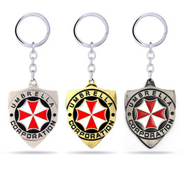 regenschirmschmuckcharme Rabatt 3 Farben Movie Series Schlüsselanhänger Resident Evil Schlüsselanhänger Red Umbrella Charms Schlüsselanhänger Key Holder Modeschmuck Schlüsselanhänger Geschenke