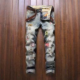 Wholesale badge embroidery designs - Wholesale-Mens Embroidery Patches Hole Jeans Straight Badge Ripped Denim Patchwork Jeans Washed Pants Fashion Design Slim Trousers 29-38