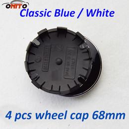 Wholesale matches logo - Best Match 4Pcs 68mm10clips ABS Aluminum black base Badge Car Wheel Emblem Hub covers Auto Wheel Logo caps Blue White Label