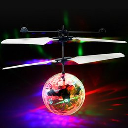 Wholesale Rc Flying Toy - Wholesale- Flying RC Ball Aircraft Helicopter Led Flashing Light Up Toy Induction Toy Electric Toy Drone For Kids Children