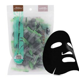 Wholesale fabric charcoal - Bamboo Charcoal Compressed Face Mask DIY Black Face Mask Non-woven Fabrics Strong Adsorption Oil Control 40pcs