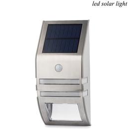 1w llevó luz exterior online-Wall cuerpo del sensor solar de luz LED luz del acero inoxidable solar infrarroja lámpara de inducción 2LED lámpara al aire libre de la lámpara PIR