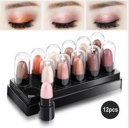 Nueva Llegada Highlighter Maquillaje 12 Colores Sombra de Ojos Stick Matte Glitter Eyeshadow Shimmer Paletas de Sombra de Ojos Fábrica Al Por Mayor desde fabricantes