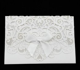 Wholesale Gold Embossed Wedding Invitations - Wholesale- 10pcs White Gold Elegant Carved Embossed Flower Laser Cut Wedding Invitations Elegant Ribbon Envelop Invitation Cards #A320c