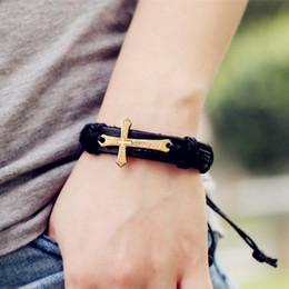 Braccialetto croce intrecciata Bibbia gioielli urbani fatti a mano in vera pelle nera regolabile braccialetto retrò gioielli all'ingrosso supplier slap wristbands wholesale da braccialetti di schiaffo all'ingrosso fornitori