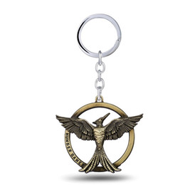 Wholesale Bird Keychains - 12 pcs lot The Hunger Games vintage retro bird Keychain can Drop-shipping Metal Key Rings For Gift Key chain Jewelry YS10996