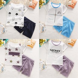 Wholesale Brand Children S Sports Suit - Summer children 's sleeved shorts suit children' s boys and girls cotton T - shirt half - sleeved sports two - piece
