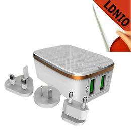 Argentina Liquidación de ventas 2 puertos USB de pared de viaje Cargador plegado UE AU EE. UU. Reino Unido toma de corriente opcional para el teléfono celular Andriod IOS caja blanca Suministro