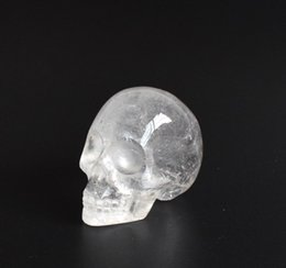 Wholesale carved crystal skulls - 1.9 INCHES Natural Tumbled Clear Quartz Carved Crystal Reiki Healing Skull Statue with a Velvet Pouch