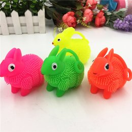 Wholesale Soft Inflatable Plastic Balls - Sell lots of toys The rabbit fur ball new strange children LED flash elastic animals