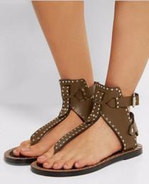 Sandales spartiates à clous noires en Ligne-Marque Designer Clouté En Cuir Sandales En Cuir Noir Mid Mid Talon Wrap Rivets Sandales Summer Gladiateurs Feminino Sandalias