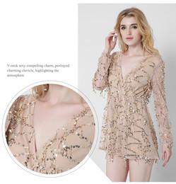 Wholesale Sleeved Gauze Dress - Europe and the United States women's new sexy long-sleeved deep V white gauze dress summer tassel sequined skirt