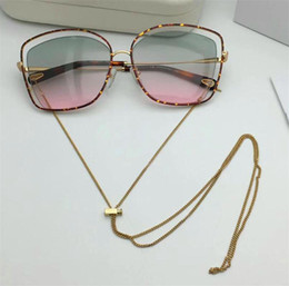Wholesale Golden Woman Chains - New fashion fashion designer women sunglasses metal hollow frame legs with chain can be adjusted and demolition trend style uv 400 lens 133