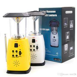 Wholesale Solar Dynamo Led Lantern - 8 LED Solar Powered Lamp Camping Lantern Lighting Dynamo Power Lamps Dynamo Powered FM Radio Light Multifunction Lamps Hand Crank Light