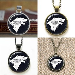 2019 casa stark winterfell 10pcs Game of Thrones L'inverno sta arrivando Stark of Winterfell Glass Photo Collana portachiavi segnalibro gemello braccialetto orecchino sconti casa stark winterfell