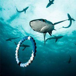 Wholesale Rainbow Bracelets Wholesale - New Silicone Bracelets 35 Colors Transparents Neon Rainbow Shark Camouflage S M L XL Sizes Energy Balance