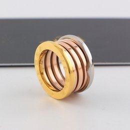 Wholesale Famous Wedding Rings - Top quality brand famous spring rings titanium steel Stainless 3 mix color ring Fashion Wedding love rings couple engraved logo Jewelry