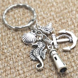 Wholesale Beach Lovers - 12pcs Beach Keychain fish anchor lighthouse seashell seahorse charm Key Ring Jewelry silver tone