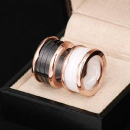 оптовые кольца стерлингового серебра Скидка Титановая сталь Оптовая керамическое кольцо по цене звезда большой любви Титановая сталь версия дуги края черный и белый керамическое кольцо