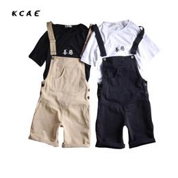 Wholesale Suspender Jeans Overalls - Wholesale- 2017 New Male Denim Jumpsuit Cotton Fabric Black And Khaki Denim Overalls Men Shorts Jeans With Suspender Size S-XXL