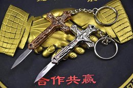 Wholesale Self Protect - 2016 New Small Crucifix Key Chain FOLD-OUT KNIFE Necklace Knife Metal GOD PROTECTS EDC Pocket Knife Xmas Gift Free Shipping