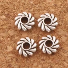 Wholesale Hot Twist - Twist Daisy Spacers Beads 5x5x1.5mm Hot MIC 600 pcs lot Tibetan Silver L670 Free shipping