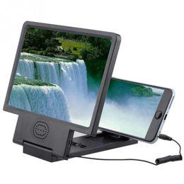 2019 lente de zoom 12x teléfono móvil Freeshipping 4PCS / lot Nueva 3D Movie Screen HD Amplifier para el teléfono móvil Universal Mobile Phone Amplifier Eyes Protection holder