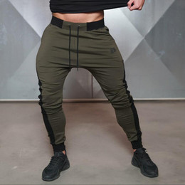 Wholesale Cotton Twill Pants - Wholesale- 2016 Brand New Gold Medal Fitness Casual Elastic Embroidered Pants Stretch Cotton Men's Pants Body Engineers Jogger Bodybuilding