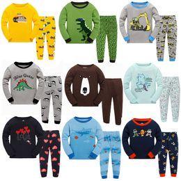 Wholesale Cute Christmas Pajamas For Girls - Baby Boys Girls Pajamas Korean Brand Cotton Long Sleeve Clothes 2pcs Cartoon Suits Sleepwear Cute Baby Home Clothing For Chrildren 2017