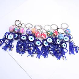 Wholesale 8mm Cartoons - Turkey evil eye keychain keyring tassrl key 8mm blue evil eye beads for women men as gift keychain key ring for fanily
