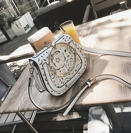 Wholesale Iron Artwork - wholesale brand new summer flowers package hollow woman saddle bag leather handbag simple lovely openwork iron hollow leather Crossbody Bag