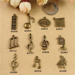 Bricolage bijoux en alliage accessoires matériels bibelots perlés à la main rétro petits instruments de musique charmes, guitare musique symbole note pendentifs ? partir de fabricateur