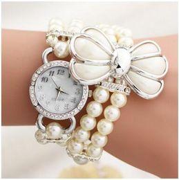 Wholesale Diamond Bow Bracelets - Fashion women pendants bracelet watches Luxury Bow Pearl Jewelry Buckle quartz casual rhinestone Diamonds wristwatches Dress watch Gifts new