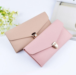 Wholesale Europe Brand Bag Wholesale - Factory wholesale brand bag Europe and pure color long purse lock litchi grain leather fashion women purse small pure and fresh leather wall