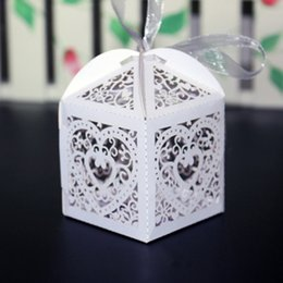 Wholesale Wholesale Pink Wedding Wrapping Paper - Candy Boxes Wedding Favors White Pink Hollow Gifts Favor Wrap Paper Love Heart Chocolate Box Holders Party Bags Laser Cut Supplies