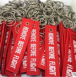 Wholesale Keyring Labels - 2017 10pcs Red Remove Before Flight Keychain Embroidery Tag Label Key Chain Bag Charm Key Ring Handbag Keyring Women Men