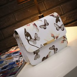 Wholesale Iron Artwork - Ms qiu dong season of the new printing iron side small bag shoulder inclined across mobile phone bag