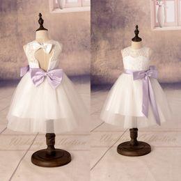 Wholesale Tea Length Open Back Wedding - 2017 Custom Flower Girl Dresses Lovely Sheer White Lace Jewel Neck Pretty A-Line Open Back Cute Lilac Bow Ribbon Communion Dress for Girls