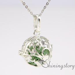 Wholesale Ceramic Balls Jewelry - ball metal volcanic stone silver heart locket oil diffuser jewelry locket with charms inside ceramic diffuser necklace openwork
