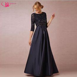 Abito nero vedere attraverso le linee online-New Brand Mum Dress See Through Lace Indietro Three Quater Sleeve Abito per la madre della sposa Nero satinato Vestido de la madre