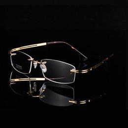 Gafas sin montura A + doradas de diseño clásico Ultra-light 9039 Memory Pure-Titanium Hombres sin montura de negocios Gafas graduadas de montura cuadrada grande desde fabricantes