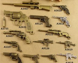 Wholesale Diy Weapon - DIY jewelry handmade materials retro 24 revolver pistol charms, ancient bronze alloy accessories rifle Machine gun pendant military weapon
